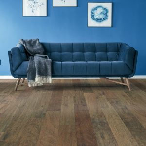 Blue couch on floor | The Carpet Stop