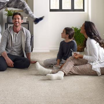 Family sitting on carpet | The Carpet Stop