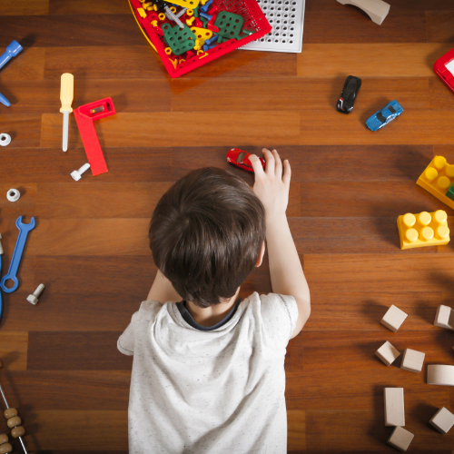 Boy playing with toy cars on vinyl flooring | The Carpet Stop
